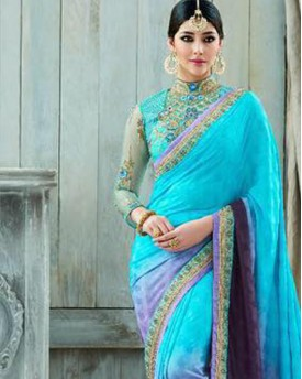 Heavy work with net blouse saree